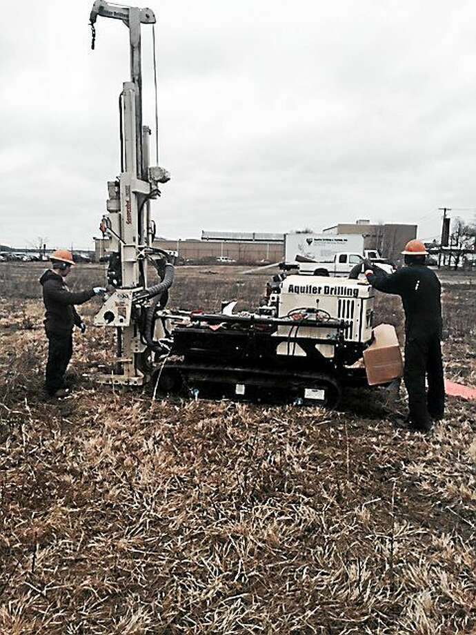 Operator Andrew Sprague, left, and assistant Robert Jackson from Aquifer Drilling & Testing Inc. of Newington take soil samples using a Geoprobe on April 9, 2015, as part of the environmental cleanup of the 4.17-acre 105 Water St. and 1.45-acre 16 Elm St. properties in West Haven. Photo: FILE PHOTO