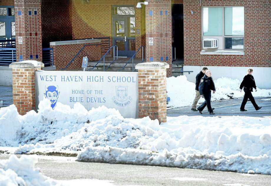 West Haven police leave West Haven High School Tuesday. Photo: Arnold Gold — New Haven Register