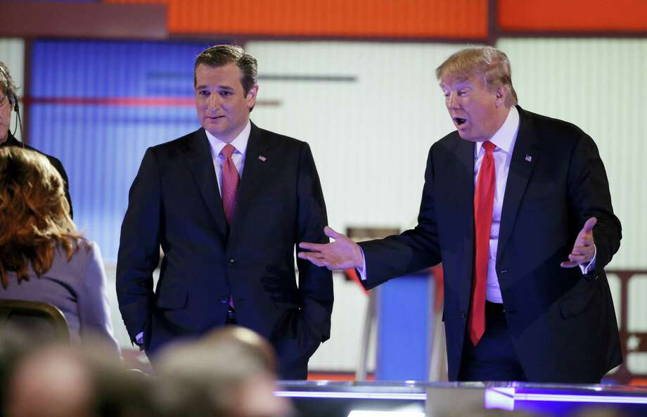 Republican presidential candidate, businessman Donald Trump  speaks with the moderators as Republican presidential candidate, Sen. Ted Cruz, R-Texas,  looks on during the Fox Business Network Republican presidential debate at the North Charleston Coliseum, Thursday, Jan. 14, 2016, in North Charleston, S.C. Photo: AP Photo/Chuck Burton / AP