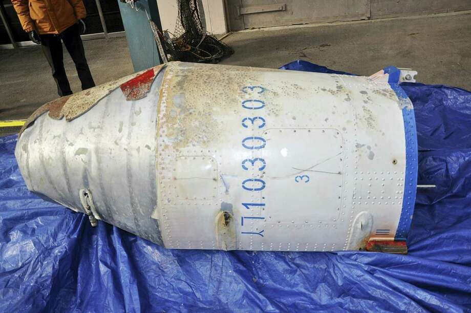 In this photo provided by the South Korean Defense Ministry, an object that the South Korean Defense Ministry believes to be a part of a North Korean rocket is displayed on a South Korean navy ship Tuesday, Feb. 9, 2016, in undisclosed location, South Korea. North Korea on Sunday, Feb, 7, 2016, defied international warnings and launched a long-range rocket that the United Nations and others call a cover for a banned test of technology for a missile that could strike the U.S. mainland. North Korea has also expanded a uranium enrichment facility and restarted a plutonium reactor that could begin recovering material for nuclear weapons in weeks or months, Photo: South Korean Defense Ministry Via AP    / South Korean Defense Ministry