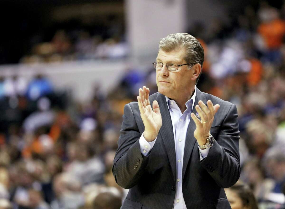 Connecticut head coach Geno Auriemma cheers for his team during the second half of a national semifinal game against Oregon State, at the women's Final Four in the NCAA college basketball tournament Sunday, April 3, 2016, in Indianapolis. Connecticut won 80-51. (AP Photo/AJ Mast)