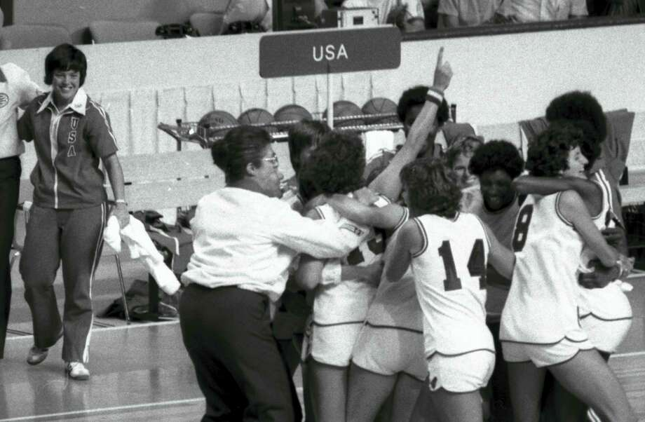 In this July 26, 1976 file photo, the U.S. women's basketball team celebrates after their women's basketball game victory over the Czechoslovakians at the 1976 Summer Olympics in Montreal. Photo: The Associated Press   / AP