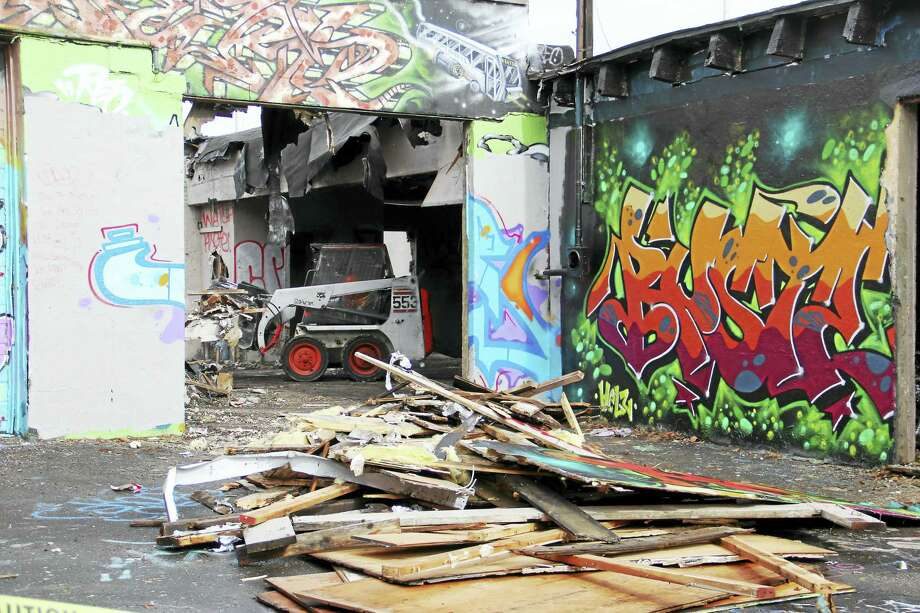 The building at 159 Water St., New Haven, also known as the Hi Cru Wall, was razed after a fire exposed further complications to the vacant building. It was known for its colorful graffiti. Photo: ESTEBAN L. HERNANDEZ — NEW HAVEN REGISTER