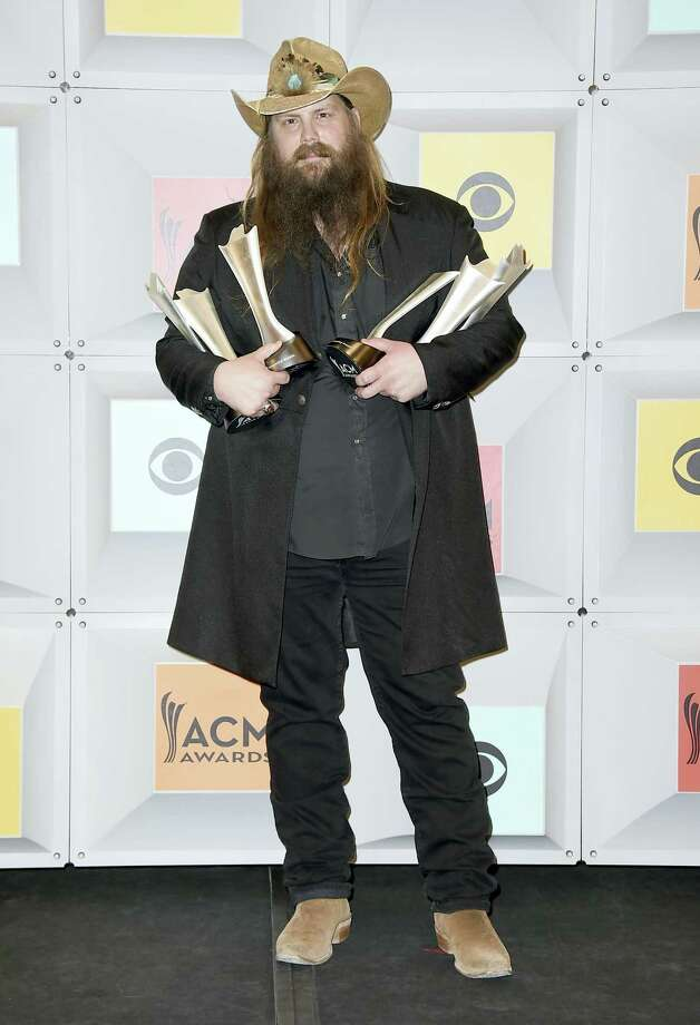 "Chris Stapleton poses in the press room with the awards for album of the year for ""Traveller"", new male vocalist of the year, male vocalist of the year and song of the year for ""Nobody to Blame"", at the 51st annual Academy of Country Music Awards at the MGM Grand Garden Arena on Sunday, April 3, 2016, in Las Vegas. (Photo by Jordan Strauss/Invision/AP) Photo: Jordan Strauss/Invision/AP / Invision"