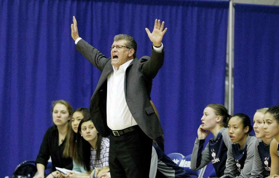 Connecticut Coach Geno Auriemma tries to get the attention of his players in the first half of an NCAA college basketball game against the University of Memphis, Wednesday, Jan. 13, 2016, in Memphis, Tenn. (AP Photo/Karen Pulfer Focht) Photo: AP / FR171263 AP