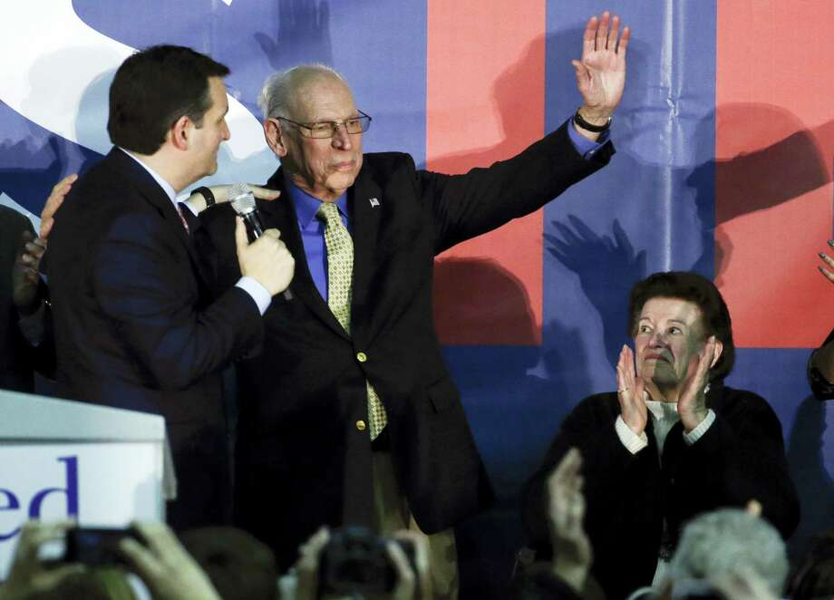 In this Feb. 1, 2016 file photo, Republican presidential candidate, Sen. Ted Cruz, R-Texas greets his father Rafael as his mother Eleanor Darragh applauds during a rally in Des Moines, Iowa. Republican front-runner Donald Trump rehashed claims Tuesday that his rival Ted Cruz's father has links to President John F. Kennedy's assassin Lee Harvey Oswald. Photo: AP Photo — Chris Carlson, File / Copyright 2016 The Associated Press. All rights reserved. This material may not be published, broadcast, rewritten or redistribu
