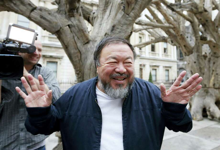 In this Tuesday, Sept. 15, 2015, file photo Chinese artist Ai Weiwei poses for photographers with one of his pieces at his exhibition at the Royal Academy of Arts in London. Chinese artist Ai Weiwei said Wednesday, Jan 13, 2016, that a change in policy by Lego to allow bulk orders of its toy bricks for projects with a political purpose is a victory for freedom of expression. Photo: AP Photo/Frank Augstein, File    / AP