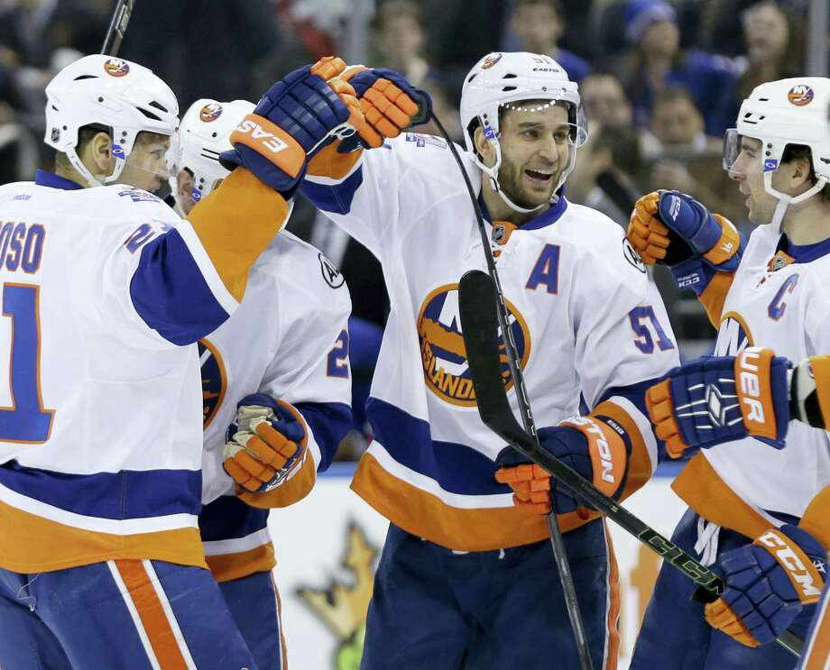 New York Islanders' Frans Nielsen, center, celebrates a goal by teammate Nick Leddy Sunday. Photo: The Associated Press   / Copyright 2016 The Associated Press. All rights reserved. This material may not be published, broadcast, rewritten or redistributed without permission.