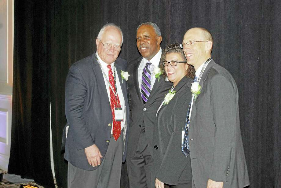 Fro l to r, CBA President William Clendenen Jr.; Justice Lubbie Harper Jr.; Vice President Karen DeMeola and President-Elect Monte Frank. Photo: Contributed