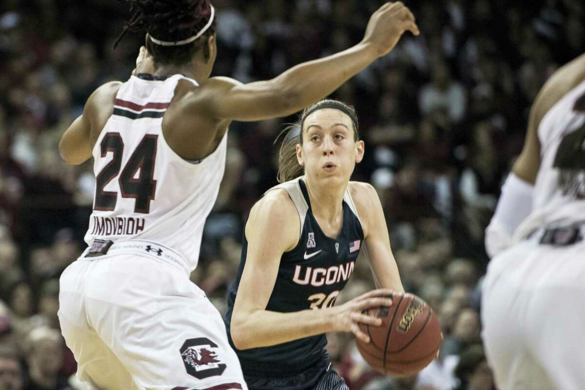 UConn forward Breanna Stewart (30) drives to the hoop against South Carolina forward Sarah Imovbioh (24) during the second half Monday. Connecticut defeated South Carolina 66-54.