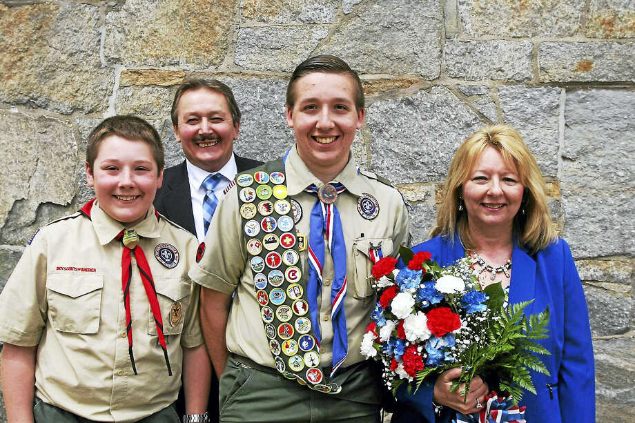 Troop 3 Eagle Scout Joseph Szewczyk, center, with his parents, Peter and Myra Szewczyk, and brother, Michael, left. Photo: Contributed Photo