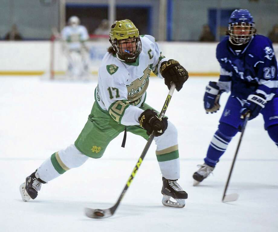 Notre Dame-West Haven's Joe Ansaldo (17) chases down a puck against cross-town rival West Haven this past weekend. His team won, 8-0. Photo: Arnold Gold — New Haven Register
