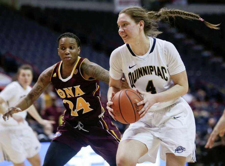 Quinnipiac forward Paula Strautmane (4) drives past Iona's Joy Adams during the second half on Monday. Photo: Mike Groll — The Associated Press   / Copyright 2016 The Associated Press. All rights reserved. This material may not be published, broadcast, rewritten or redistributed without permission.