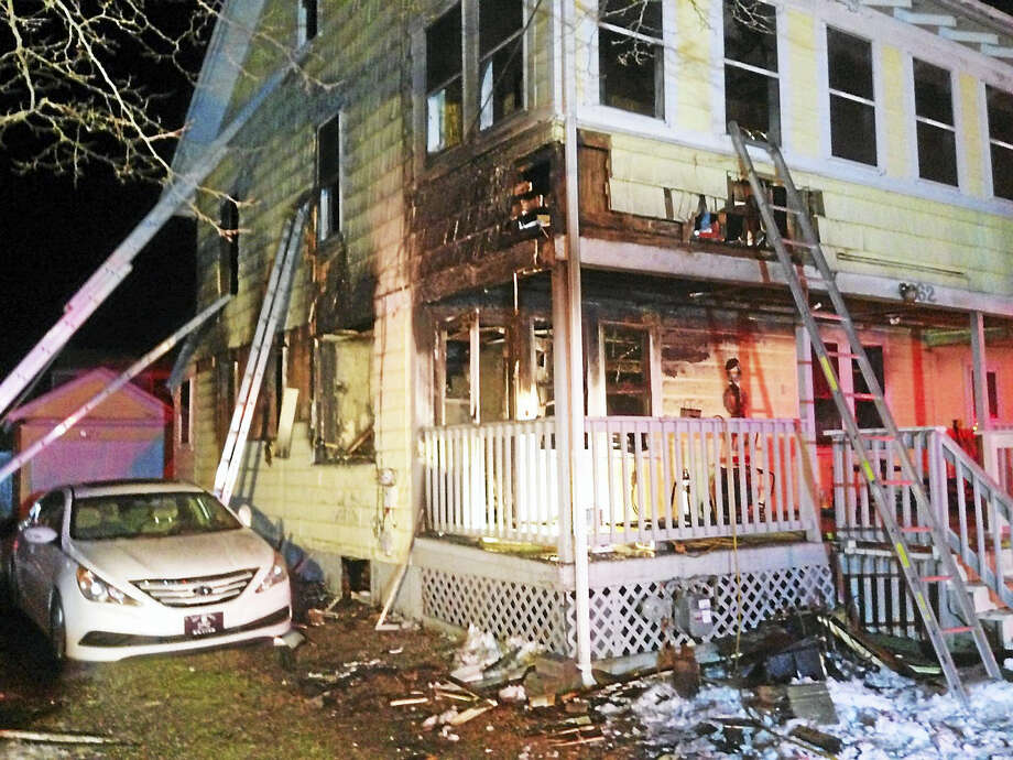 Two people were displaced and a home at 162 4th Ave. in Milford was damged after a fire broke out Sunday night, Feb. 7, 2016. The cause of the fire remained under investigation Monday. Photo: Photo Courtesy Of The Milford Fire Department