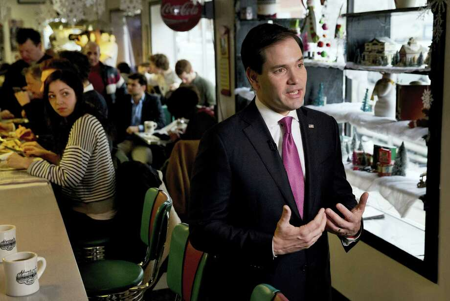 Republican presidential candidate Sen. Marco Rubio, R-Fla., is interviewed during a campaign stop at Norton's Classic Cafe in Nashua, N.H., Monday. Photo: The Associated Press   / AP