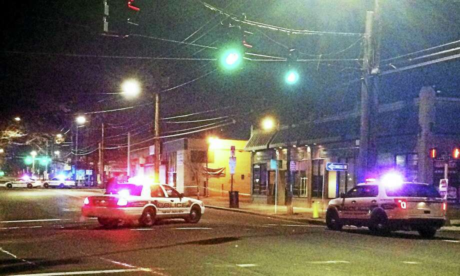 Grand Avenue was shut down for several hours early Monday between Ferry and Poplar streets after one person was seriously hurt in a hit-and-run crash. Photo: Wes Duplantier — New Haven Register