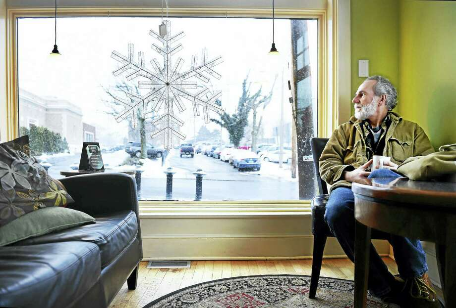 Arnold Gold — New Haven Register  Mark McNeiece of Milford watches the weather from inside Cafe Atlantique in Milford on Monday morning 2/8/2016. Photo: Journal Register Co.