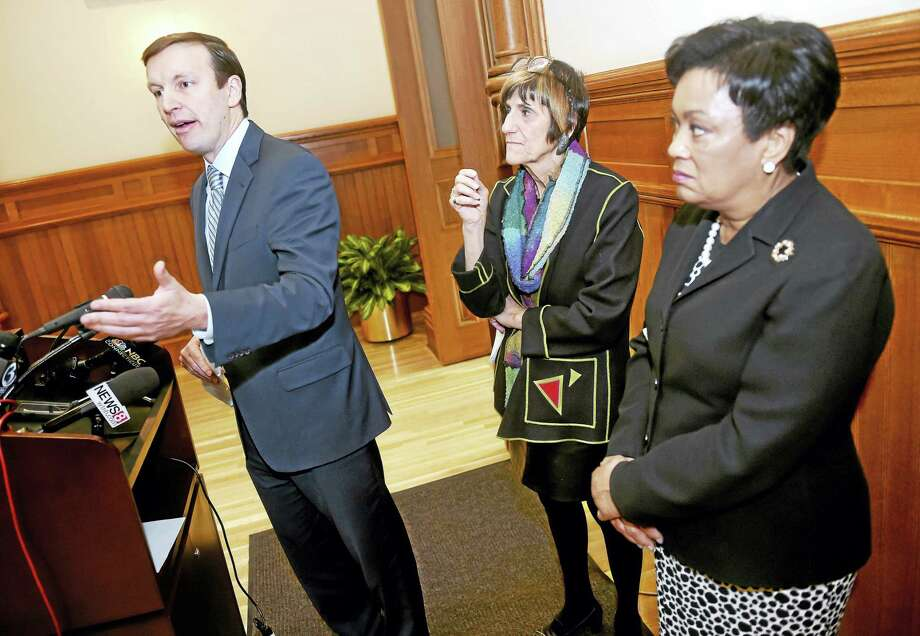 From left, U.S. Sen. Chris Murphy, U.S. Rep. Rosa DeLauro and New Haven Mayor Toni Harp answer questions at City Hall in New Haven Tuesday concerning congressional efforts to have the Department of Housing and Urban Development increase oversight and inspections of housing. Photo: Arnold Gold — New Haven Register
