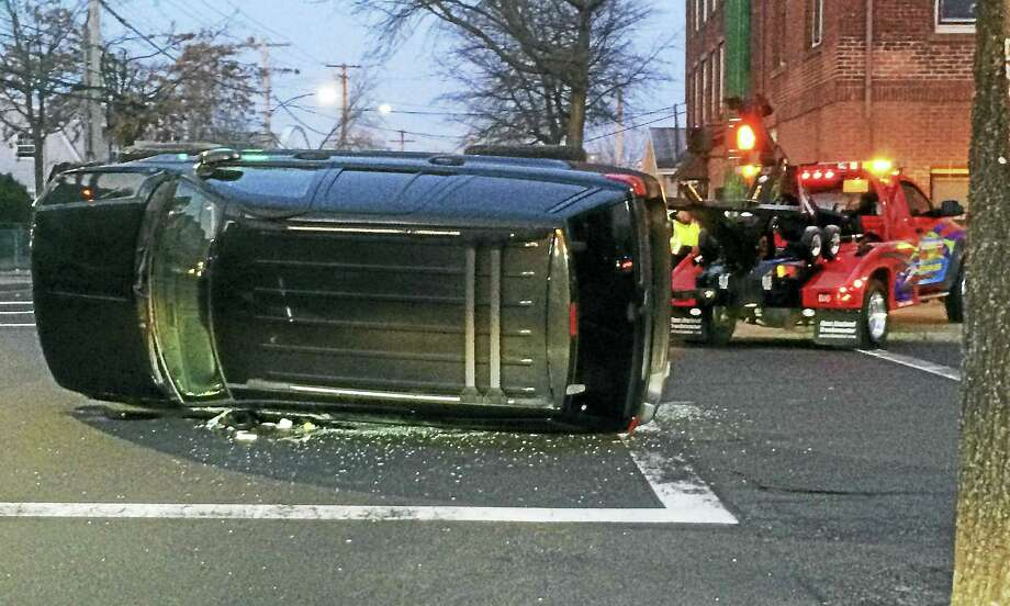The intersection of Grand Avenue and James Street in New Haven was shut down for about an hour Monday morning after a crash involving an SUV. No one was seriously hurt in the crash. Photo: Wes Duplantier — New Haven Register