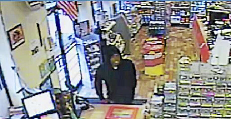 Wallingford police are asking for the public's help to identify this man who they say brandished a gun and demanded money from a store clerk Tuesday at the Henny Penny gas station, 77 N. Turnpike Road. Photo: Photo Courtesy Of Wallingford Police Department