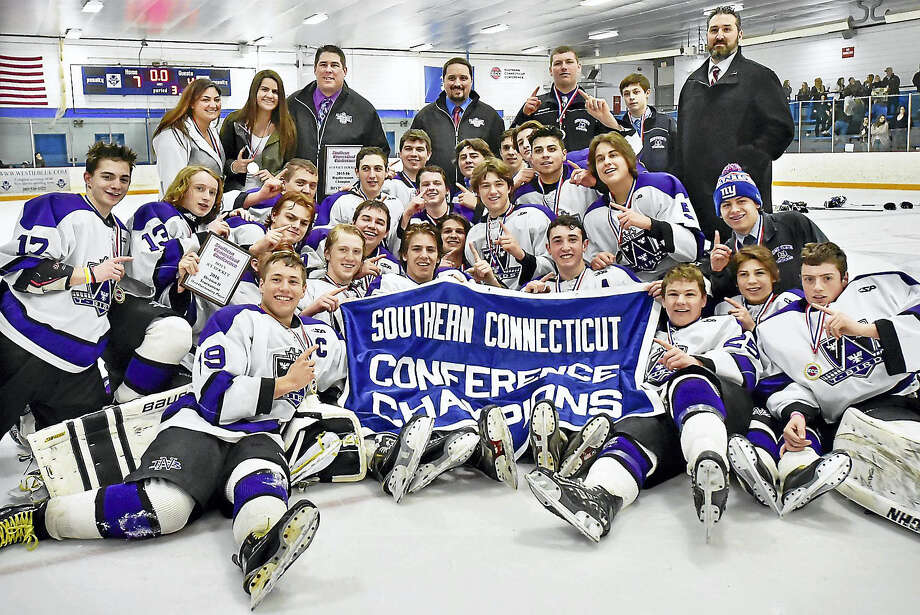 The North Branford Thunderbirds celebrate their 7-4 win over the Cheshire Rams in the SCC Division II hockey championship game on Saturday, March 5, 2016 at the Edward L. Bennett Rink in West Haven. Photo: Catherine Avalone — New Haven Register