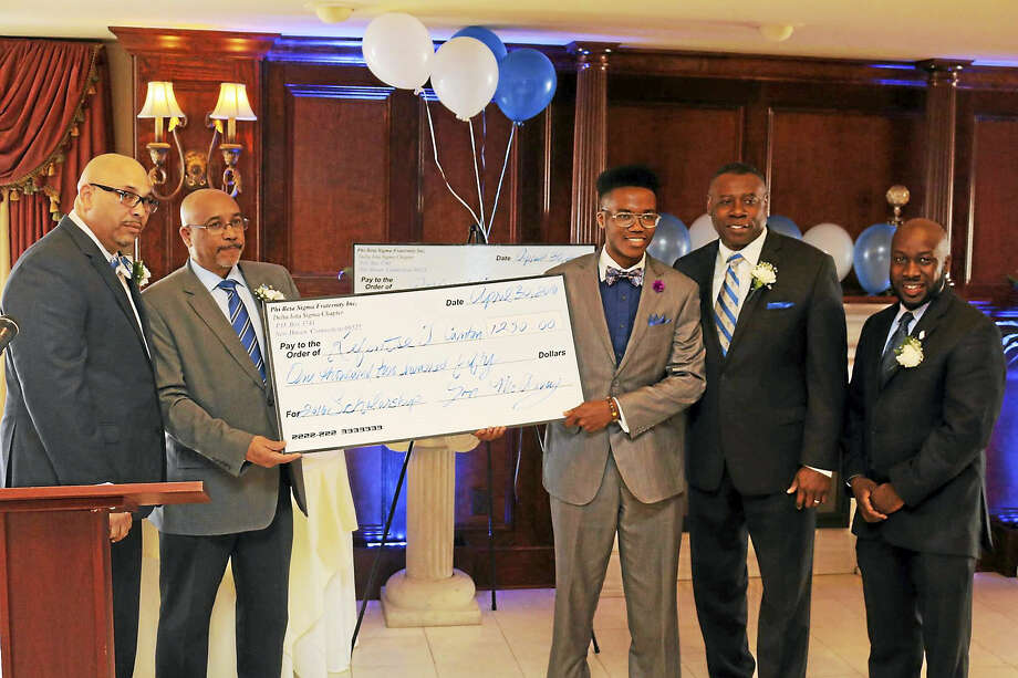 Kefentse T. Canton of Hamden High School accepts a $1,250 scholarship at an annual Scholarship Luncheon hosted by the Crescent Club of Delta Iota Sigma Chapter of Phi Beta Sigma Fraternity Inc. April 30. Photo: Contributed Photo