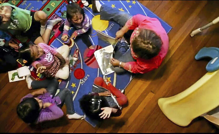 """(Screen capture) Chidren at the El Buen Camino, or """"The Good Path"""" Day Care Center in West Haven Photo: Journal Register Co."""