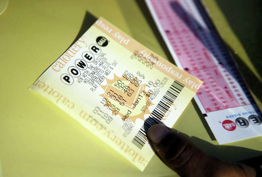 A Powerball ticket is shown Wednesday, Jan. 13, 2016, in San Lorenzo, Calif. The Powerball jackpot for Wednesday night's drawing is at least $1.5 billion, the largest lottery jackpot in the world. Photo: AP Photo/Marcio Jose Sanchez / AP