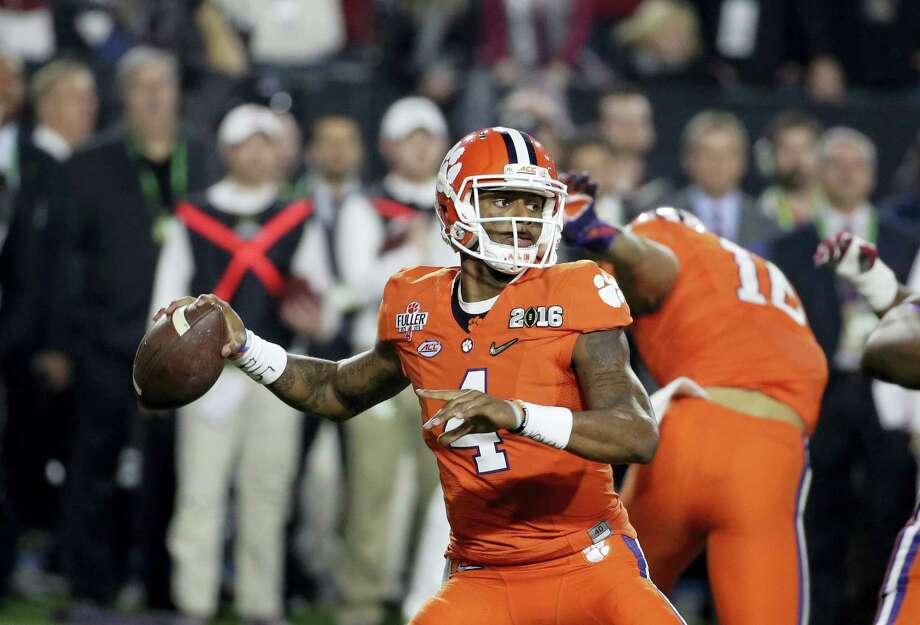 Clemson's Deshaun Watson (4) throws during the first half of the NCAA college football playoff championship game against Alabama, Monday, Jan. 11, 2016, in Glendale, Ariz. (AP Photo/Chris Carlson) Photo: AP / AP