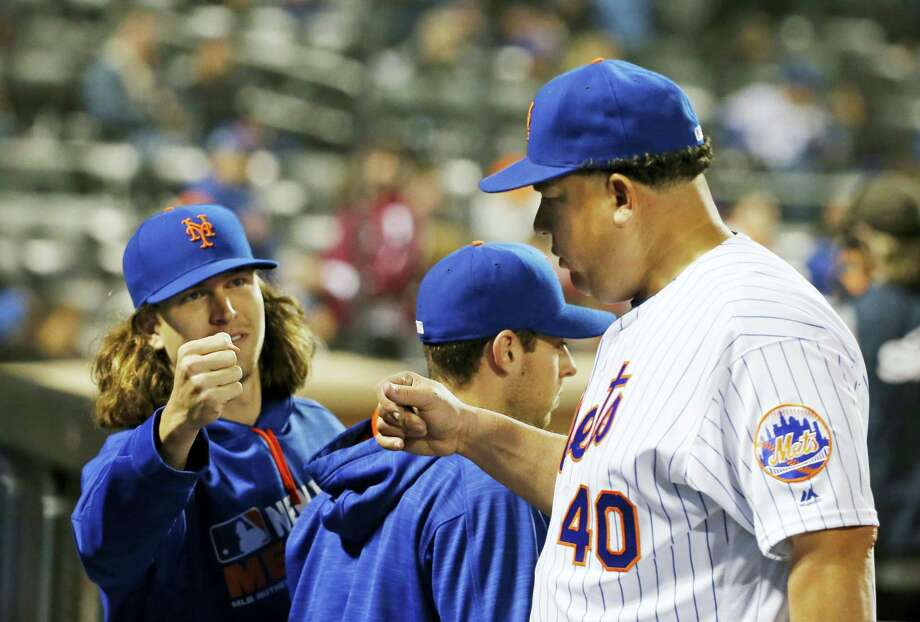 New York Mets starting pitcher Jacob deGrom (48) greets the Mets starting pitcher Bartolo Colon (40) after Colon pitched through eight innings of the Mets 4-1 victory over the Atlanta Braves Monday in New York. Photo: Kathy Willens — The Associated Press   / Copyright 2016 The Associated Press. All rights reserved. This material may not be published, broadcast, rewritten or redistribu