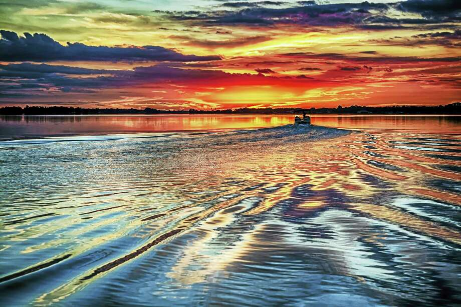 A beautiful sunset on the water in quiet Mt. Dora, Florida. Photo: Photo Courtesy Of William Burkle