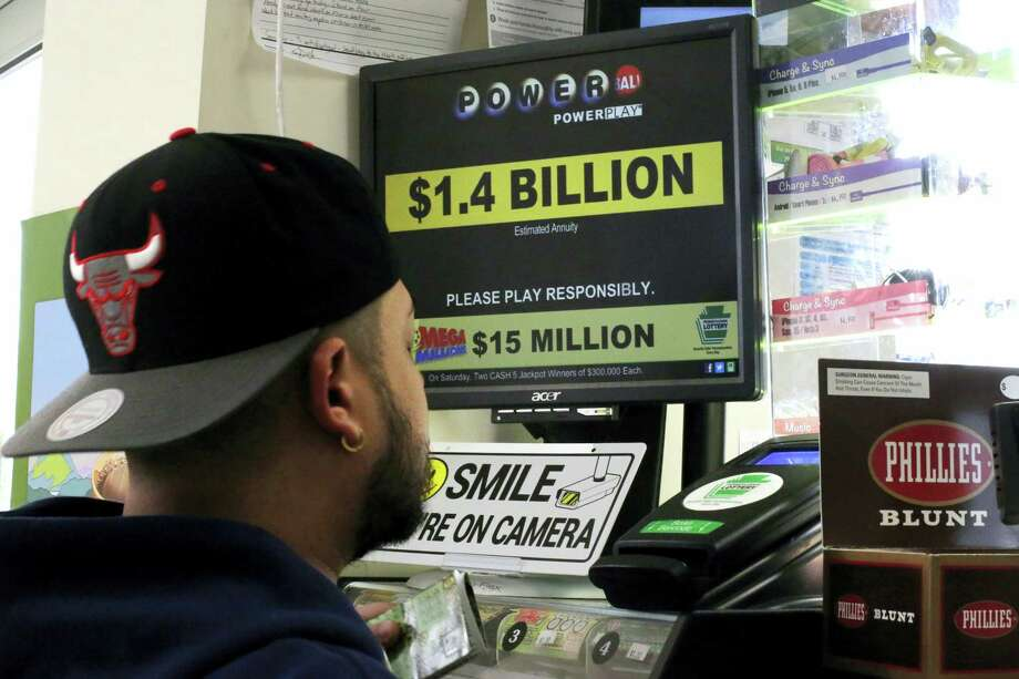 A man buys Powerball tickets at a convenience store in Lancaster, Pa., on Monday. Photo: AP Photo   / AP