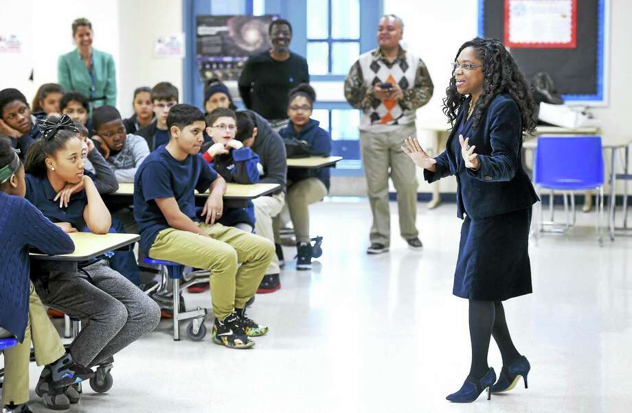 Judge Angela Robinson speaks to seventh-graders about the Rev. Martin Luther King Jr. at Mauro-Sheridan Science, Technology & Communications Interdistrict Magnet School Tuesday in New Haven. Photo: Arnold Gold — New Haven Register