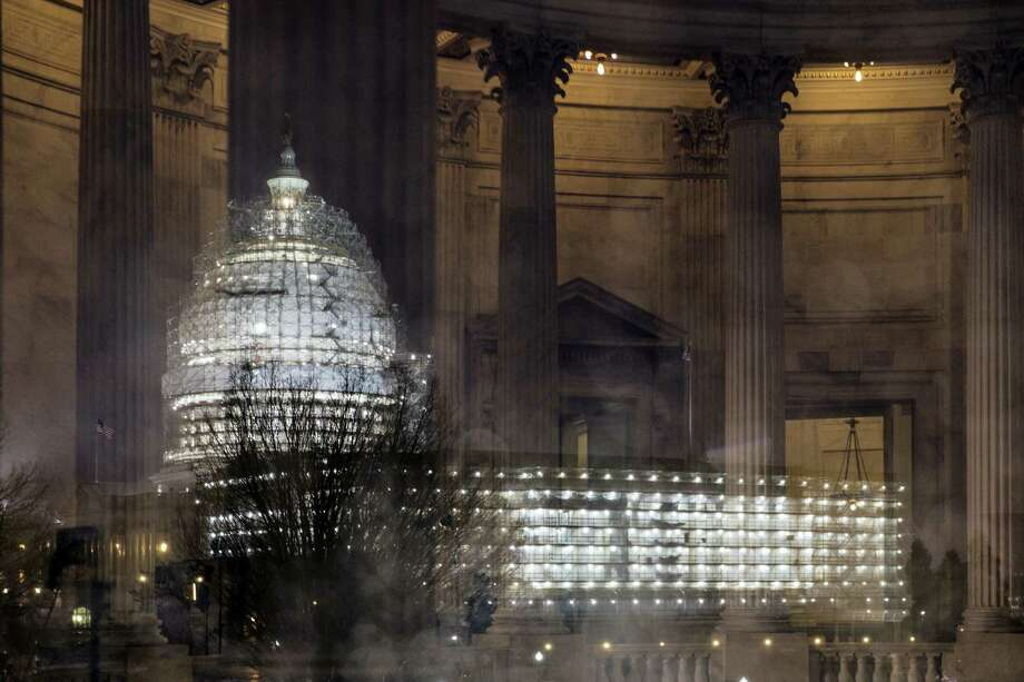 In this Feb. 24, 2016 photo, the Capitol in Washington is illuminated during a thunderstorm with the rotunda of the Russell Senate Office Building reflected on the rain-covered windows. Congress increasingly is defined by what it's not doing this election year. The Senate returns this week with a strong majority of Republicans saying no to confirmation hearings and a vote on President Barack Obama's Supreme Court nominee. Photo: AP Photo/J. Scott Applewhite, File   / AP