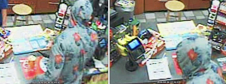 Milford police released two photos of a person who allegedly held up the Mobile on the Run gas station on the Boston Post Road on Friday, April 29, 2016. The suspect allegedly showed a black handgun during the robbery. Photo: Photo Courtesy Of The Milford Police Department