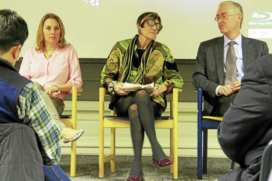 From left: Pamela Mautte, of BHCare, U.S. Rep. Rosa DeLauro, D-3, and Stephen Merz, of Yale-New Haven Hospital, hold a discussion on Monday after the screening of an HBO documentary at the New Haven Free Public Library. Photo: Esteban L. Hernandez/New Haven Register