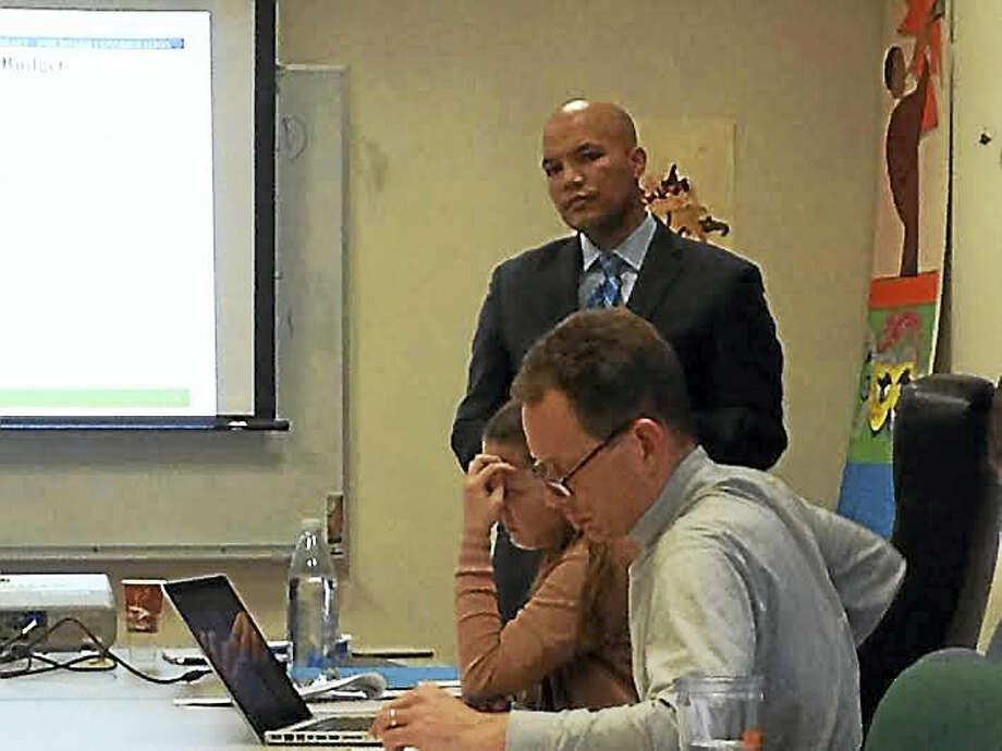 New Haven Public Schools Chief Financial Officer Victor de la Paz presents a draft budget proposal Monday. Photo: (Brian Zahn - New Haven Register)