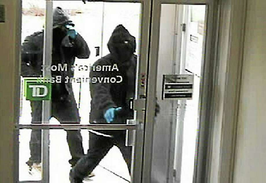 Police released this of the robbery at the TD Bank on Amity Road in Woodbridge on March 12, 2014. Photo: Woodbridge Police Department