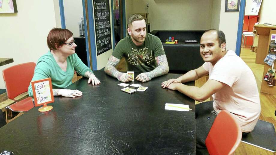 Trish Loter, Matt Loter and Vishal Patel of Happiness Lab/Elm City Games. Photo: Jason C. Diaz — New Haven Register