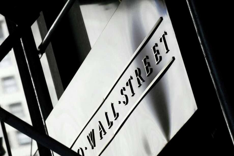 A sign for Wall Street outside the New York Stock Exchange, in New York. Photo: AP Photo/Mark Lennihan, File   / AP