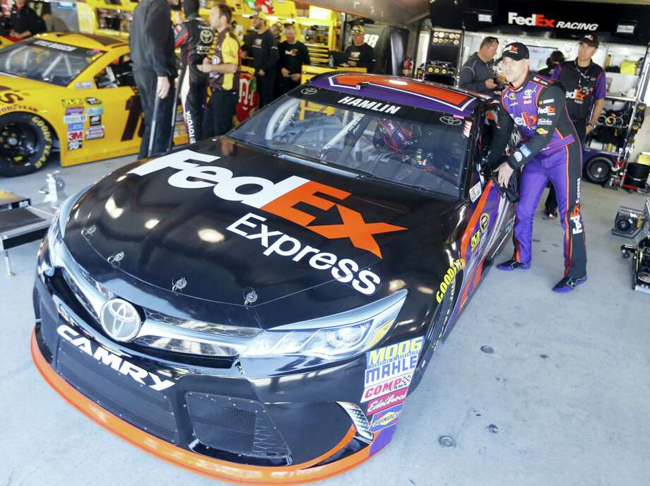 Driver Denny Hamlin gets ready for the final practice for Sunday's race at Martinsville Speedway. Photo: Steve Helber — The Associated Press   / Copyright 2016 The Associated Press. All rights reserved. This material may not be published, broadcast, rewritten or redistributed without permission.