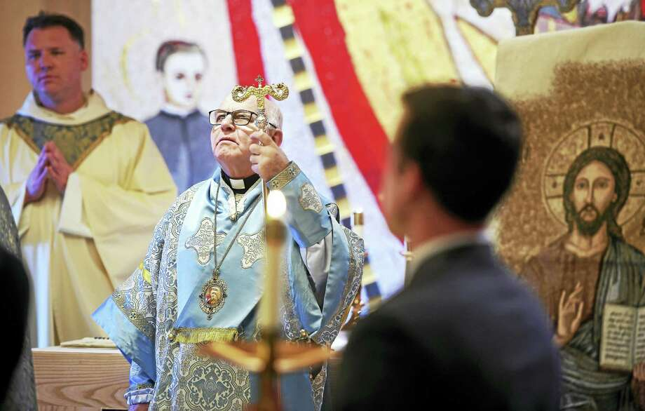 Greek Melkite Archbishop Jean Clement Jeanbart of Aleppo, Syria, celebrates Mass at the Knights of Columbus headquarters in New Haven Monday. Photo: Arnold Gold — New Haven Register