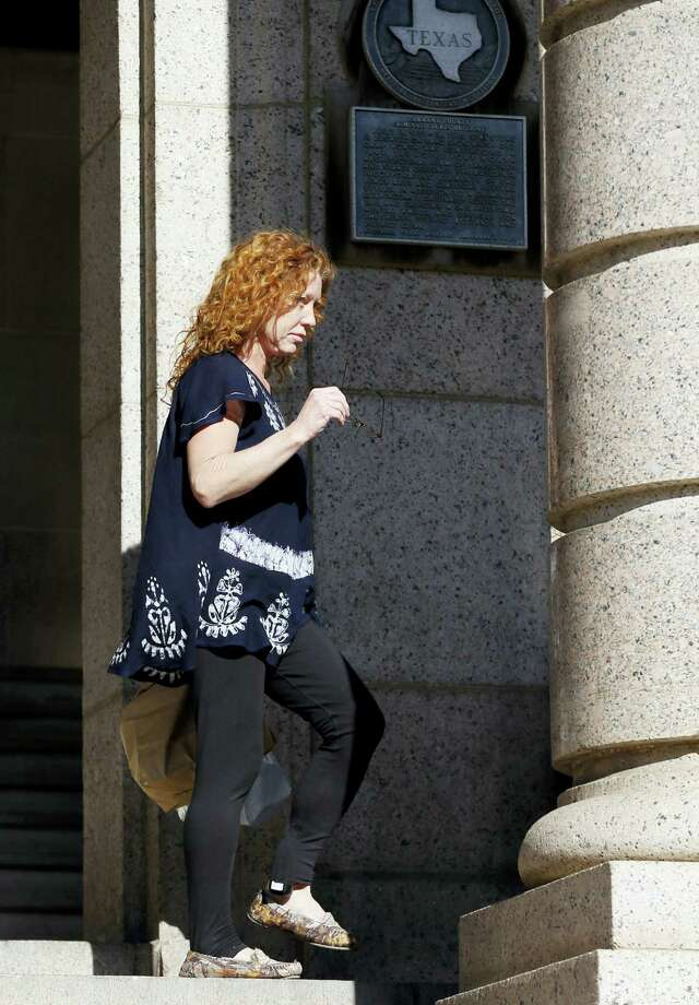 """Wearing an electronic ankle GPS monitor on her left ankle, Tonya Couch, the mother of a Texas teen who used an """"affluenza"""" defense in a drunken wreck, leaves Tarrant County Community Supervision and Corrections Department on Tuesday, Jan. 12, 2016, in Fort Worth, Texas. A judge decreased Couch's bond Monday from $1 million to $75,000. Couch is charged with hindering the apprehension of a felon after she and her son, Ethan Couch, were caught in a Mexican resort city. Photo: AP Photo/Brandon Wade / FR168019 AP"""