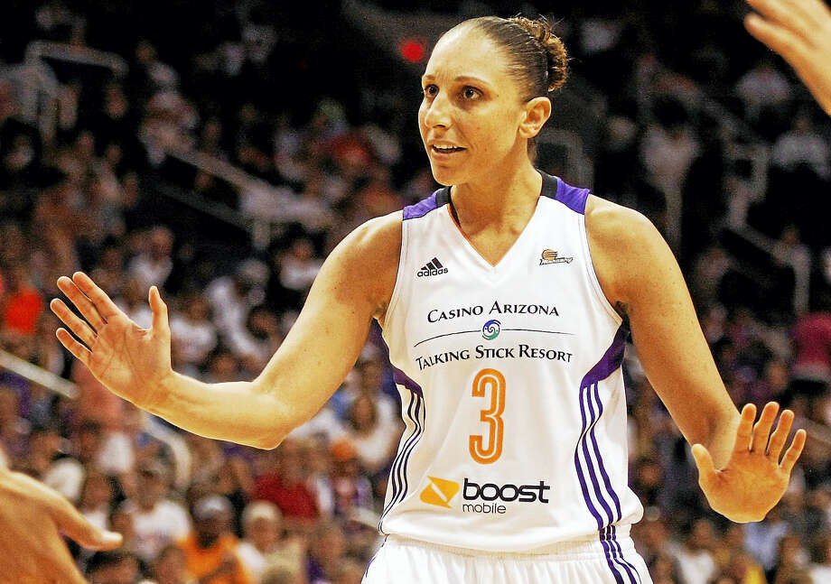 Register columnist Chip Malafronte agrees with former UConn star Diana Taurasi that lowering the rims to 9 feet for women's basketball would be a bad idea. Photo: The Associated Press File Photo   / FR157181 AP