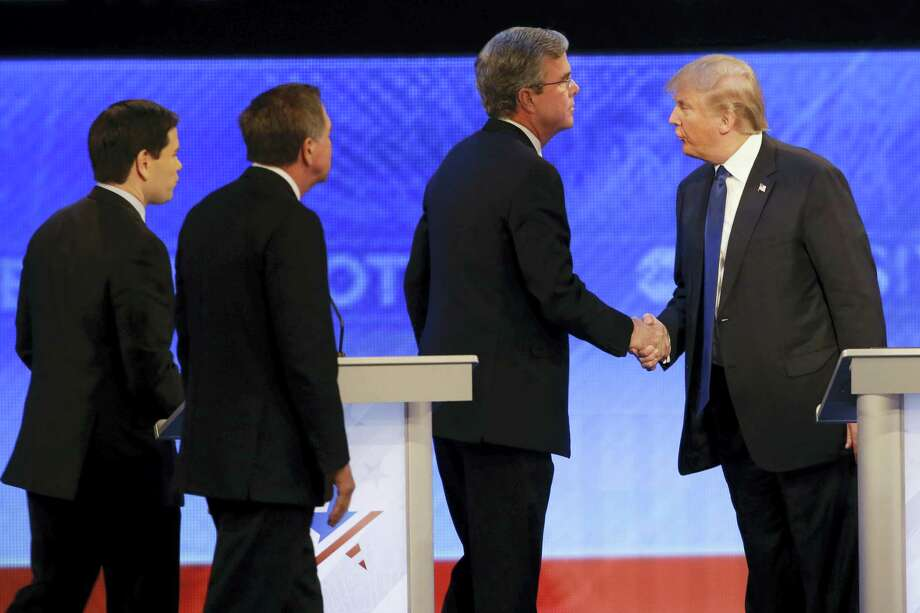 Republican presidential candidate, businessman Donald Trump  shakes hands with Republican presidential candidate, former Florida Gov. Jeb Bush as Republican presidential candidate, Sen. Marco Rubio, R-Fla., and Republican presidential candidate, Ohio Gov. John Kasich  walk past after a Republican presidential primary debate hosted by ABC News at the St. Anselm College  Saturday, Feb. 6, 2016, in Manchester, N.H. (AP Photo/David Goldman) Photo: AP / AP