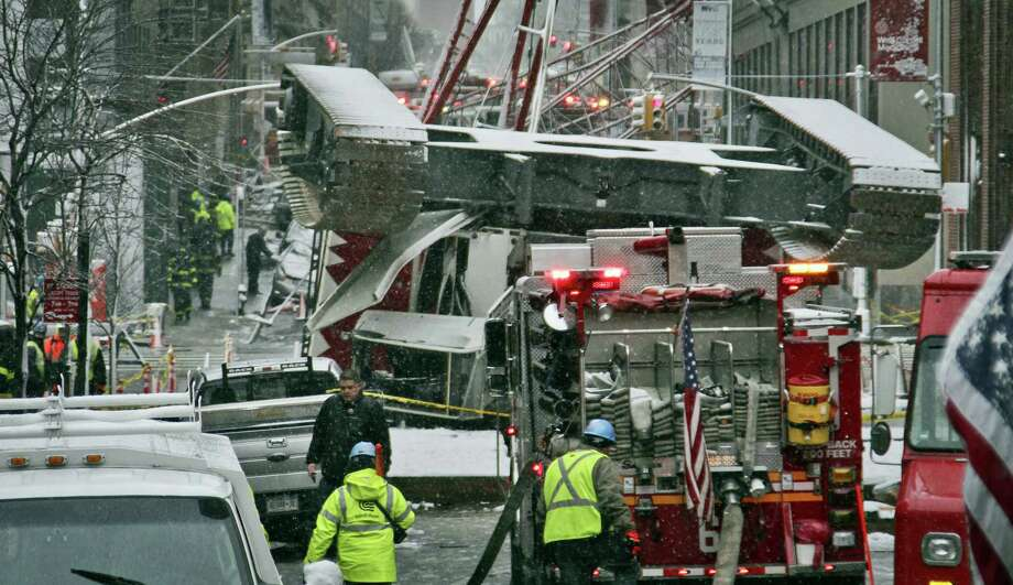 A collapsed crane lies on the street on Feb. 5, 2016 in New York. The crane landed across an intersection and stretched much of a block in the Tribeca neighborhood, about 10 blocks north of the World Trade Center. Photo: AP Photo/Bebeto Matthews   / AP