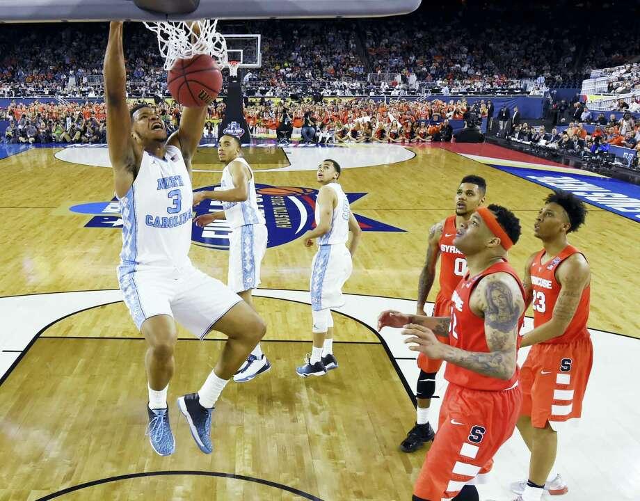 North Carolina forward Kennedy Meeks (3) dunks the ball against Syracuse on Saturday. Photo: The Associated Press   / NCAA Photos