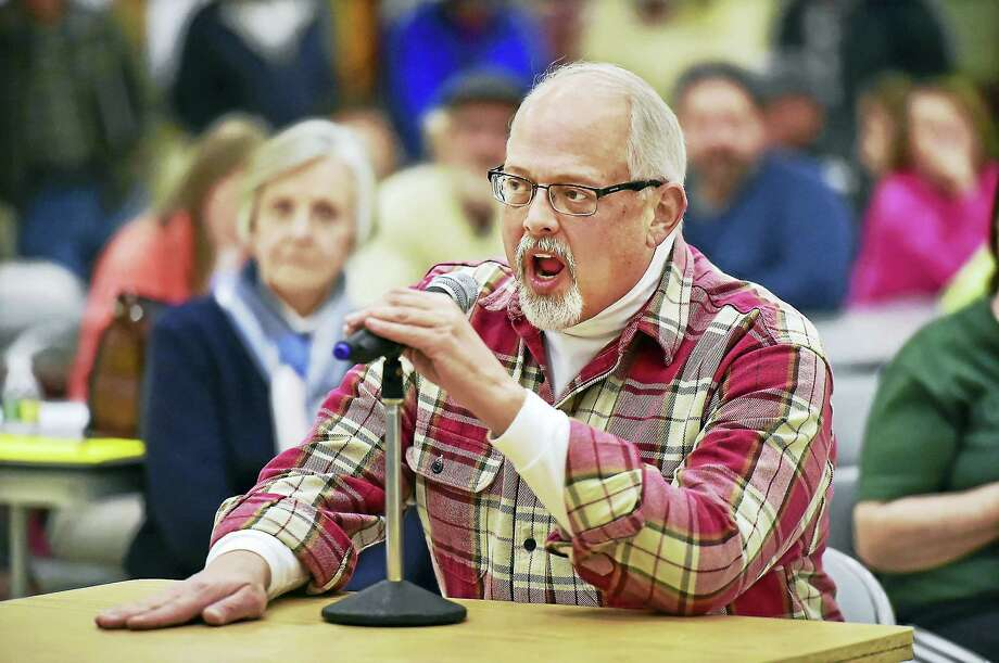 "East Haven architect Jim Harding speaks Tuesday during a meeting regarding the renovation of 200 Tyler St., the former East Haven High School. ""Promise me, all the people here tonight, 200 Tyler Street will not turn into Section 8 housing. I want what the town needs and not what a developer needs,"" he said. ""Once a project starts, it is very hard or impossible to stop it. I'm concerned for the long-term health of East Haven."" Photo: Catherine Avalone — New Haven Register    / New Haven RegisterThe Middletown Press"