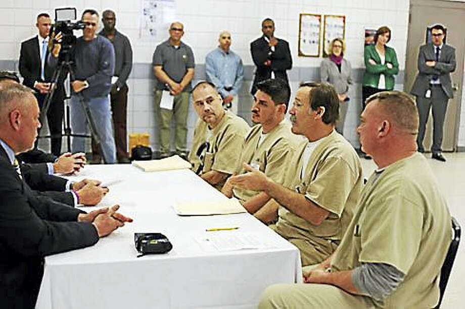 Joe Oatlui, Richard King, Scott Corna, and Ernest Burgeson speak with Gov. Dannel P. Malloy, Correction Commissioner Scott Semple and Cybulski Warden John Tarascio about their experiences. Photo: Christine Stuart — CT News Junkie