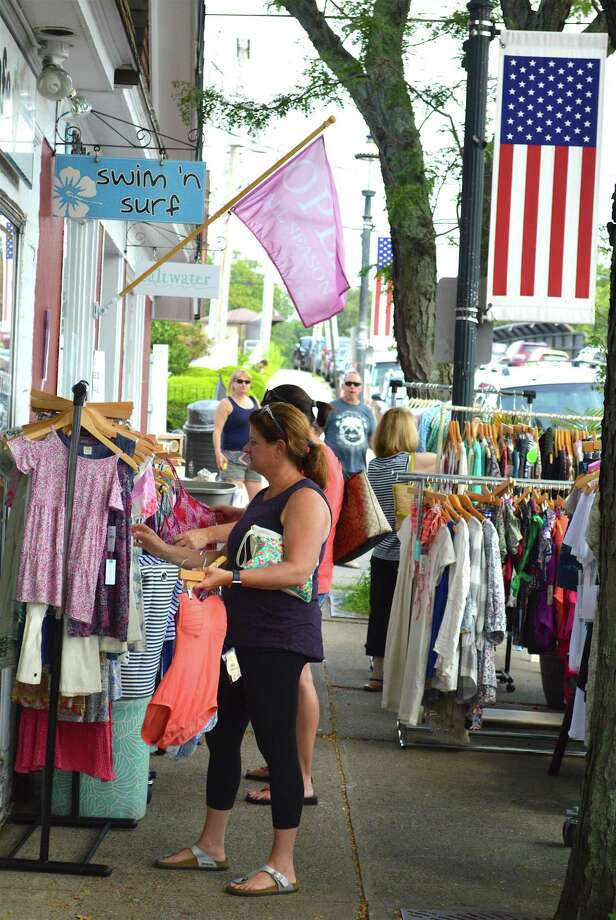 Ali Mitchell of Fairfield takes a look at some clothes on Unquowa Road during the Fairfield Sidewalk Sale & Street Fair, Saturday, July 22, 2017, in Fairfield, Conn. Photo: Jarret Liotta / For Hearst Connecticut Media / Fairfield Citizen News Freelance